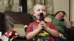 Spencer singing with his new microphone