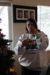 Ellen putting ornaments on the tree