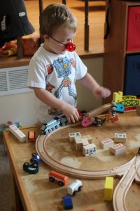 Spencer playing with the Spencer train