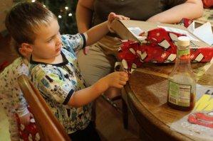 Spencer helps open Grandpa's present