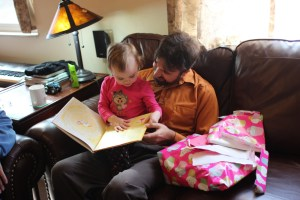 Meg and Rob reading her new Pinkalicious book.