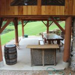 Shelter with a bark bar and picnic tables