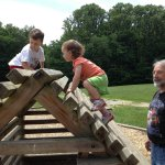 Grandpa and the kids at McCormick Creek State Park house playground