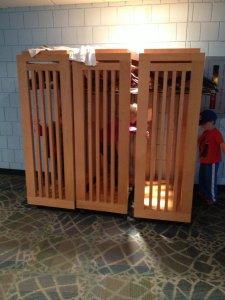 Kids play on te coat racks