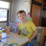 Spencer enjoys bagels with peanut butter in the RV