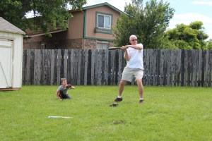 Spencer is catcher while Grandpa Felty gets ready to swing