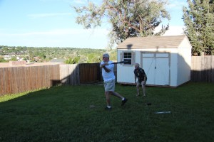 Uncle Phil takes a turn as catcher while Grandpa Felty swings