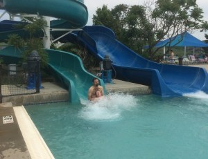 Spencer and Rob splashing down the slide