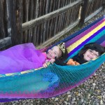 Meg and Amelia in their costumes in a hammock