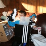 Spencer opening his new football cleats