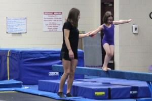 Meg on the balance beam