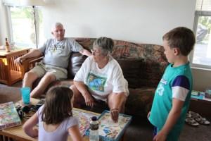 Meg, Grandma, and Spencer playing monopoly