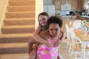 Sadie giving Meg a piggyback ride