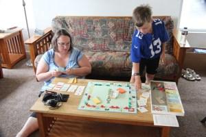 Spencer hustling his mom at Monopoly