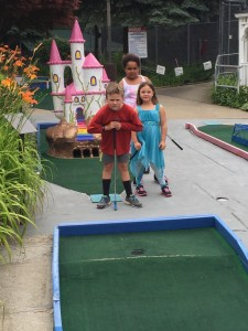 Spencer, Sadie, and Meg serious about putt-putt