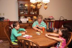 Spencer, Meg, and Grandma playing Uno