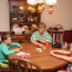 Spencer, Meg, and Grandma playing Uno