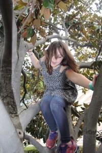 Meg climbing a tree