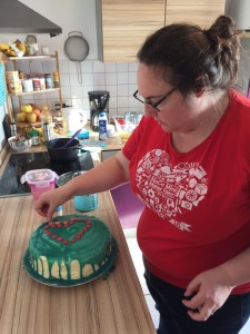 Clare putting finishing touches on Meg's cake
