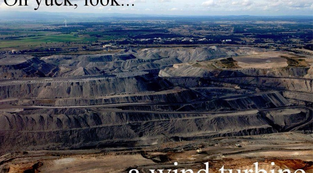 The ugliness of an open cut coal mine compared to a wind turbine