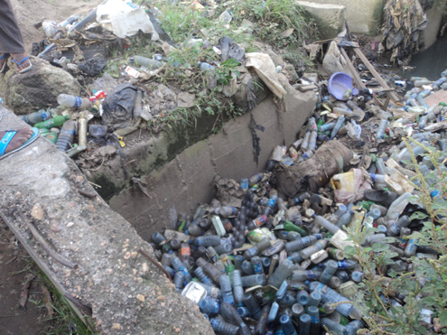 platics bottle dirty lagos roadside blocks drainage system Nigeria