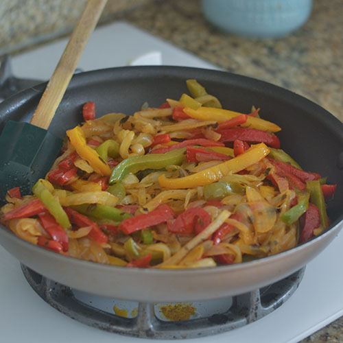 Sautéing of the Multi-Colored Peppers and Onions