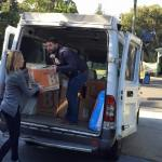 This is an image of DB Schenker loading the Winter Care Kit boxes to bring them to the Sydney Homeless Connect event