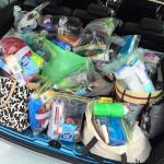This is an image of a car boot full of donations