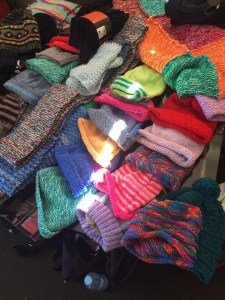 This is an image of Hand knitted scarves and beanies