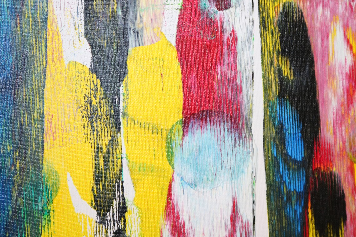 abstract art with yellow, black, red, and white streaks