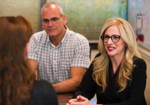 Pam Feinberg-Rivkin and Steve Feldman speaking at a meeting