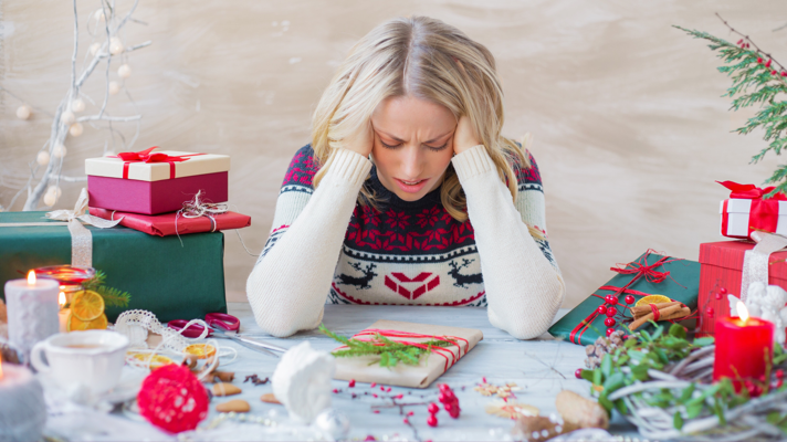Woman in a holiday sweater looking stressed