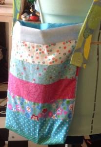 Patchwork driver bag with adjustable strap
