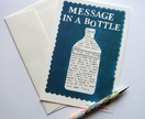literally put your MESSAGE IN A BOTTLE set of four notelets