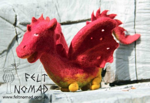 A fully wet felted dragon toy, very sturdy, ready to get into any plays.