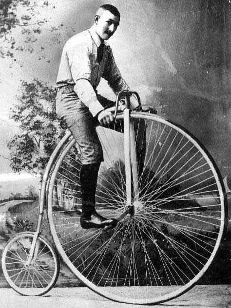 man on an old bicycle