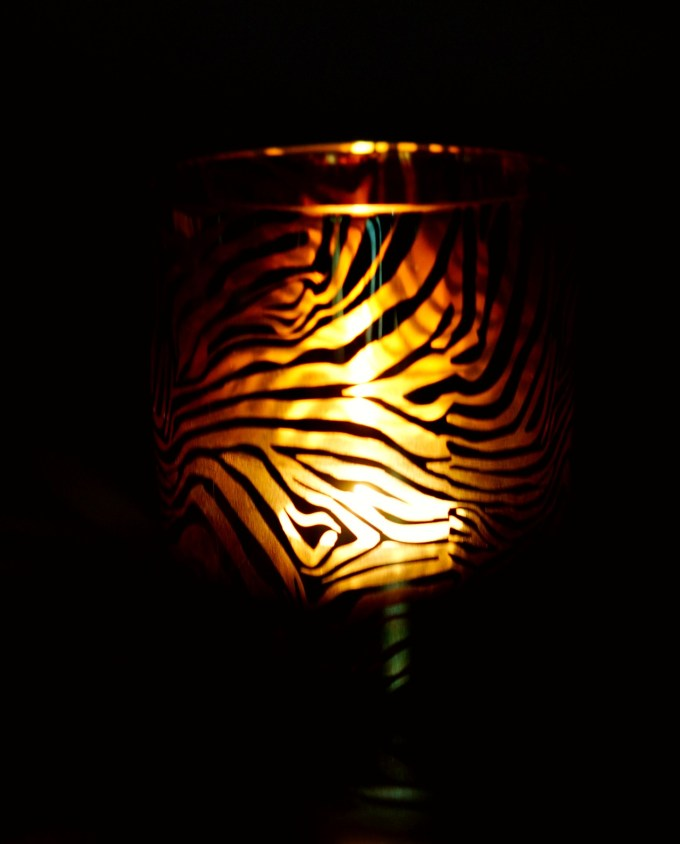 Votive glass of tealight with gold zebra pattern lighted