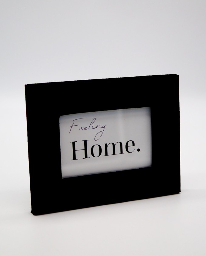 Wooden picture frame with black velvet fabric exterior