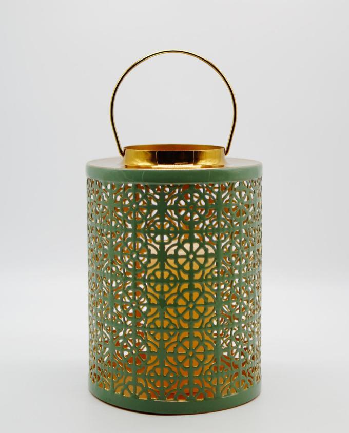 Lantern made of metal in light pastel green color. Dimension: height 26 cm, diameter 19 cm