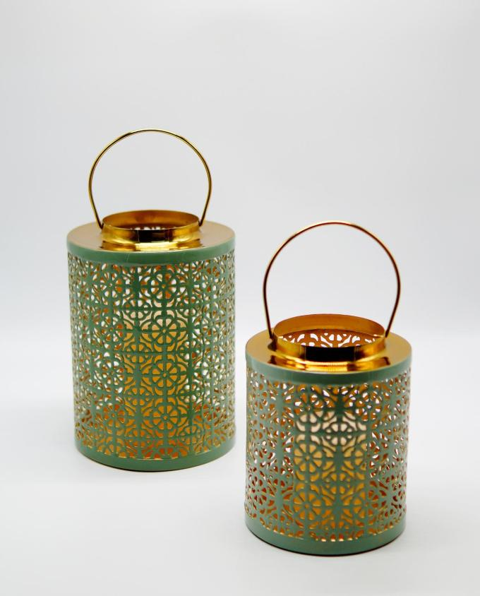 Lanterns made of metal in light pastel green color