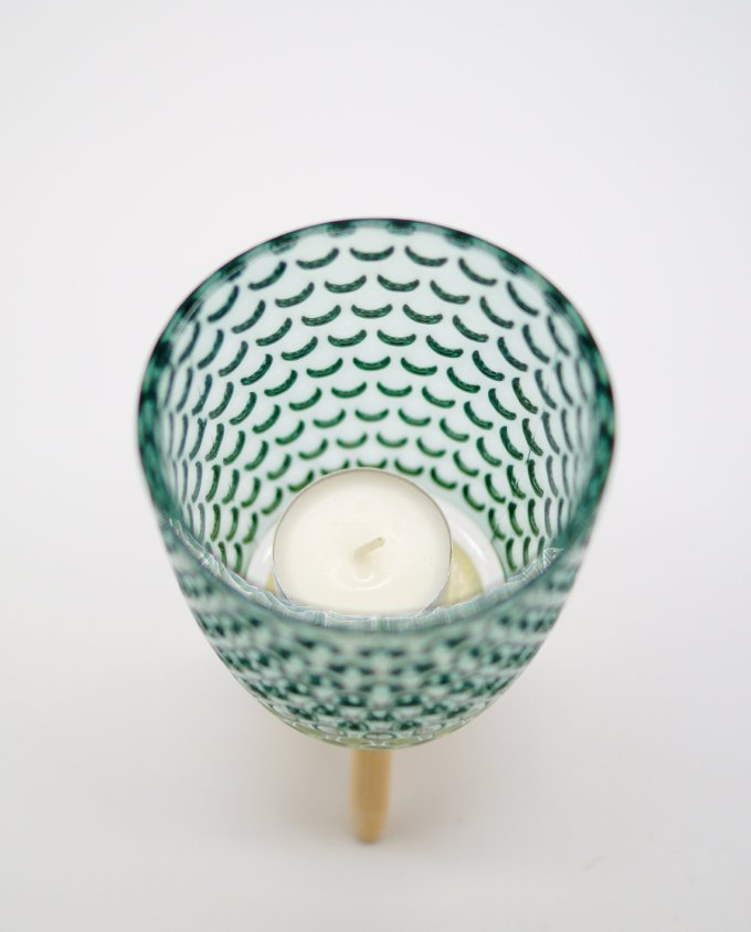 Votive of tealight light green glass with wooden legs