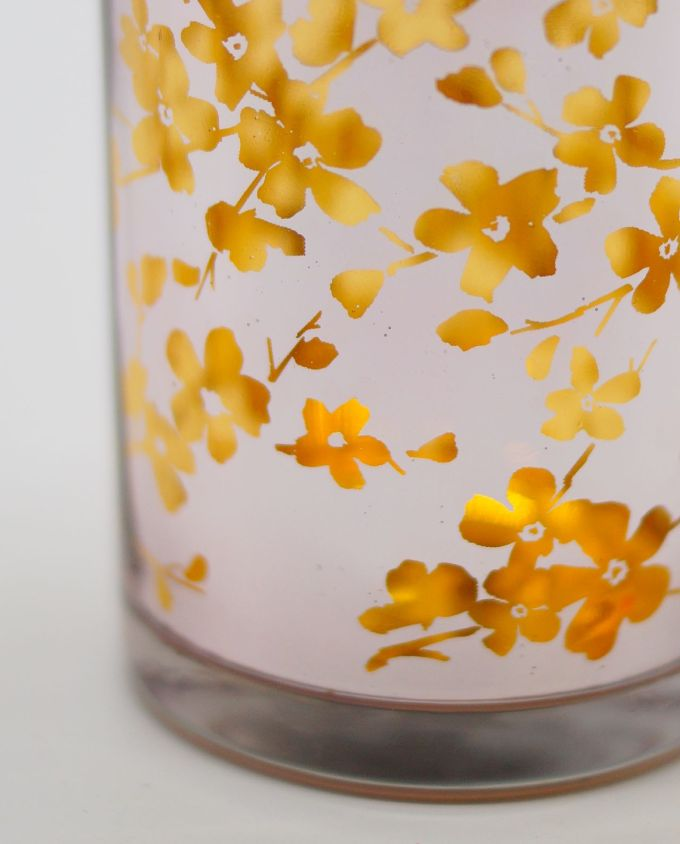 Votives of tealight metallic lilac glass with inner gold flowers