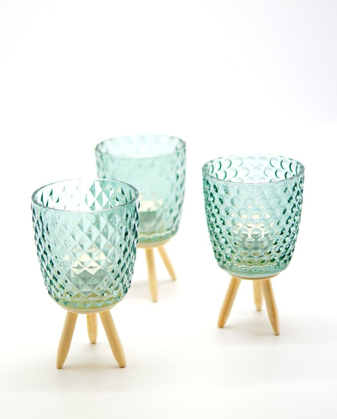 Votives of tealight light green glass with wooden legs