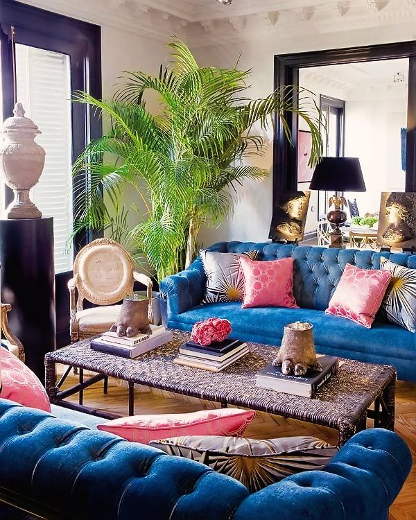 Pink in the Living Room Blue Velvet Button Tufted Couches with Pink Throw Pillows and Indoor Plant Decor