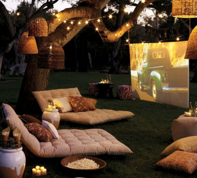 Outdoor Living Spaces Backyard Theatre with Cushioned Reclined Seating and Projector