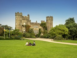 Group of friends sitting outside Malahide Castle, Dublin