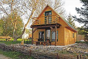 Holzblock  Ferienhaus mit Boot und Seeblick direkt am