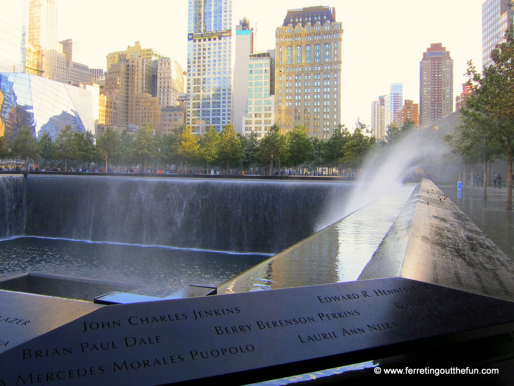 Wind sprays water over the memorial walls.