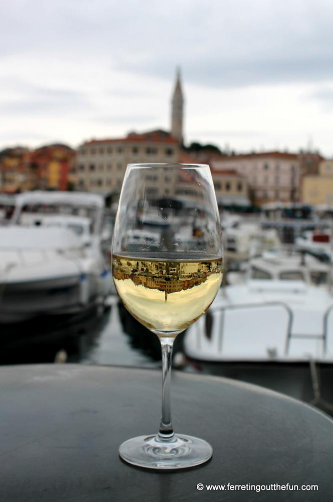 Rovinj, Croatia reflected in a glass of white wine