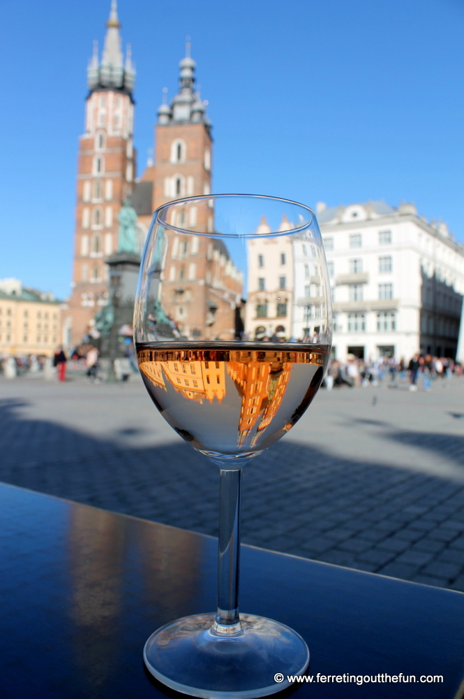 St Marys Basilica reflected in a wine glass in Krakow, Poland